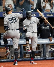 Jul 5, 2019; St. Petersburg, FL, USA; New York Yankees right fielder Aaron Judge (99) celebrates with shortstop Didi Gregorius (18) after hitting a home run in the first inning against the Tampa Bay Rays at Tropicana Field.