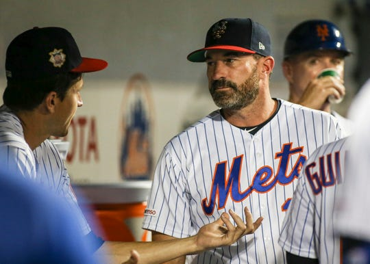 Jul 5, 2019; New York City, NY, USA; New York Mets pitcher Jacob deGrom (48) talks with manager Mickey Callaway (36) in the seventh inning against the Philadelphia Phillies at Citi Field.