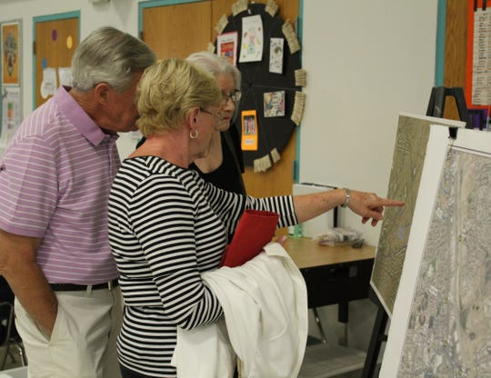 Residents who attended a June 20 meeting study maps and the data collected from groundwater testing below the closed Foothills landfill.
