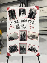 "Photos of Lt. Col. Robert ""Bob"" Friend are seen at a public viewing held Saturday at the Palm Springs Air Museum. Friend, one of the last surviving Tuskegee Airmen, died in June at age 99."