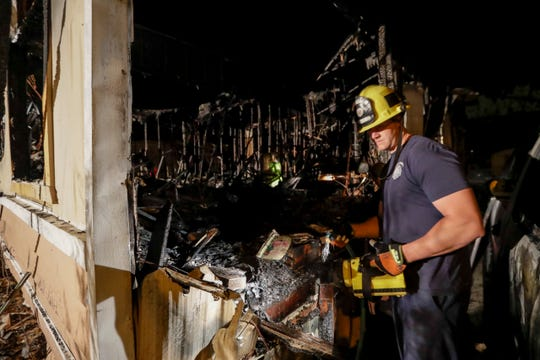 A fireman looks over a home Saturday, July 6, 2019 that burned after a earthquake in Ridgecrest, Calif. The Friday evening quake with a magnitude of about 7.1 jolted much of California, cracking buildings, setting fires, breaking roads and causing several injuries while seismologists warned that large aftershocks were expected to continue for days, if not weeks. ( AP Photo/Marcio Jose Sanchez)