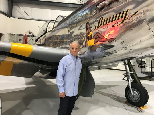 "Veteran Greg Alaimo poses with Lt. Col. Robert ""Bob"" Friend's plane ""Bunny"" at Friend's viewing on Saturday at the Palm Springs Air Museum."