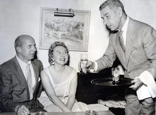 "Jimmy Van Heusen and Mollie Considine at Mike Romanoff's On The Rocks with ""Prince"" Mike himself in attendance circa 1960s to early 1970s."