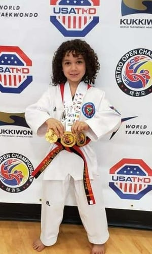 Lebanon's Joshua Aguirre, 7, keeps adding to an ever-growing collection of national and international medals in taekwondo competition.