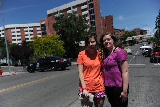 Students Jordan Perea, left, and Emma Spingler pose together in from of Argentina Hall on the campus of the University of Nevada, Reno campus on July 6, 2019. Perea and Spingler have been roommates in Argentina Hall this summer.