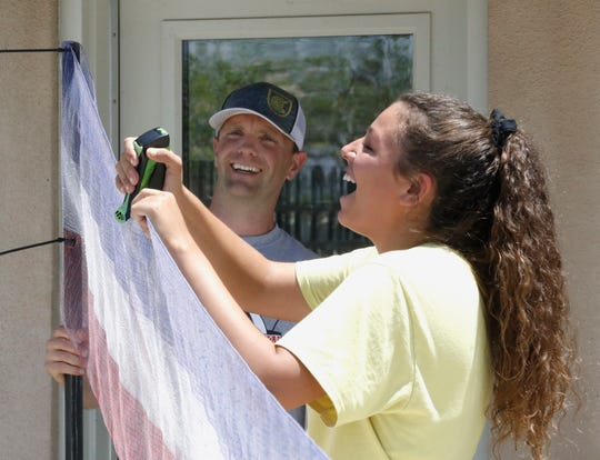 California Soccer Park executive director Chad New, left, and employee Aurora Vasquez assemble a red, white and blue banner Saturday, July 6, 2019, in preparation for a community watching party Sunday morning for the Women's World Cup championship.