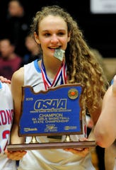 South Salem guard Katie McWilliams holds the championship trophy on March 14, 2015.