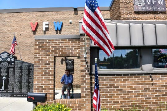 Flags are displayed near the entrance to the VFW Granite Post 428 Saturday, July 6, 2019, in St. Cloud.