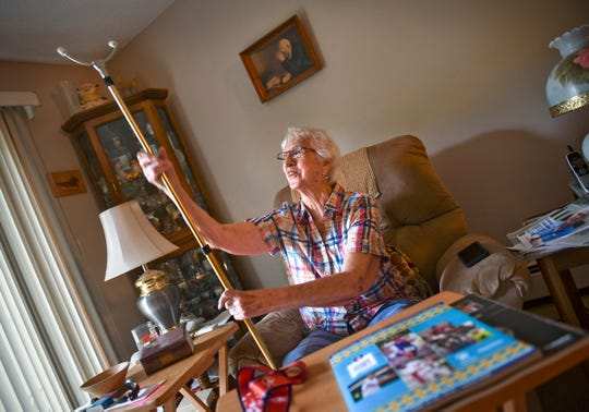Violet Halverson holds her shuffleboard cue while talking about her recent experience as a silver medalist in the recent National Senior Games during an interview Friday, July 5, 2019, at her home in Sartell.