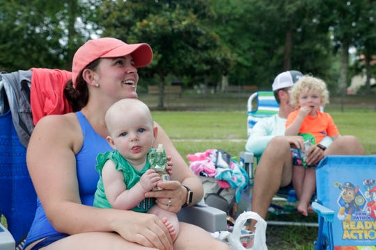 Maya Key, laughs while her daughter Emma Rose Key, 6 months, eats a snack at Wakulla Springs Saturday, July 6, 2019.