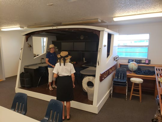 Chapman School of Seamanship president Jennifer Field shows a guest the boating simulator in one of the maritime school's classrooms in Stuart.