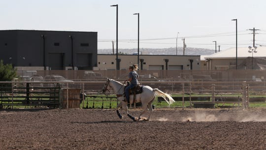 A Clint woman takes an idyllic  West Texas ride Wednesday, July 3, 2019, on her 6-acre property beside the Border Patrol Station where unaccompanied children are being held. Several dignitaries have held protests at the site recently.