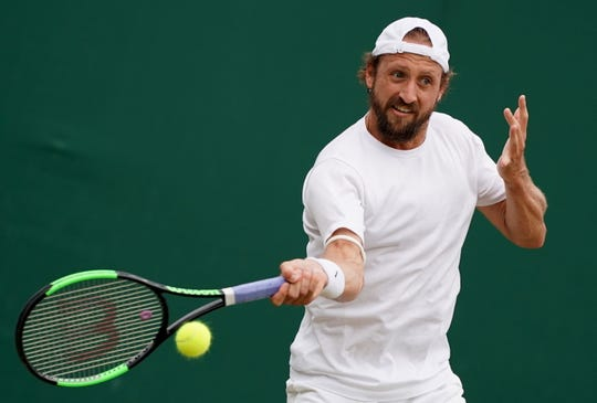 Tennys Sandgren hits a forehand during his win over Italian Fabio Fognini at Wimbledon on Saturday. Sandgren will face Sam Querrey in an all-American matchup Monday.