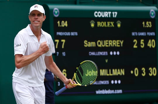 Sam Querrey celebrates after beating Australia's John Millman in straight sets in a third-round match at Wimbledon on Saturday.