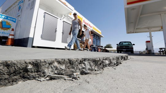 A crack is seen in a gas station's driveway in the aftermath of an earthquake Saturday in Trona. Crews in Southern California assessed damage to cracked and burned buildings, broken roads, leaking water and gas lines and other infrastructure Saturday after the largest earthquake the region has seen in nearly 20 years jolted an area from Sacramento to Las Vegas to Mexico.