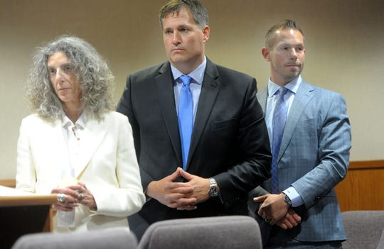 "From left, Vicki Podberesky, Bill Haney and Theodore ""Ted"" Rath, right, watch the jurors leave Friday during Rath's trial. Rath, Los Angeles Rams strength and conditioning coach, is accused of three counts of sexual battery and has pleaded not guilty."