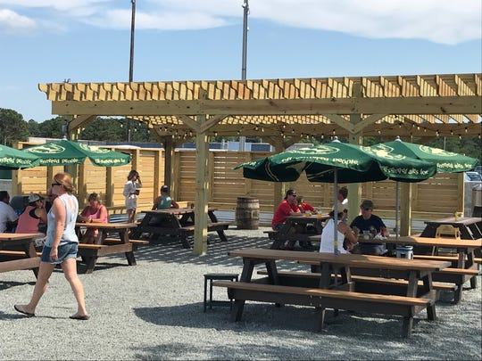 A Dogfish Head food truck selling burgers, brats and beers is now parked at the Cape May-Lewes ferry terminal in Lewes. You can eat at one of the picnic tables.