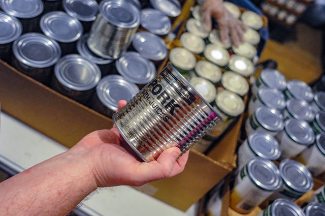 In this May 15, 2019 photo, canned meat from Lakeside Foods in Owatonna, Minn., was purchased by the USDA to offset losses from the ongoing trade wars with China, Mexico and other countries.