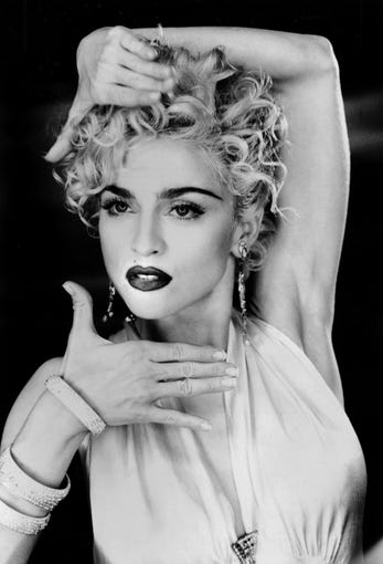 Madonna posed in a 1990 handout photo. --- DATE TAKEN: 1990  By Lorraine Day   , Source: Sire Records       HO      - handout ORG XMIT: PX92691