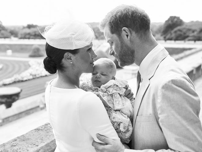 Prince Harry and Duchess Meghan with their son Archie Harrison Mountbatten-Windsor at Windsor Castle with the Rose Garden in the background on July 6, 2019.