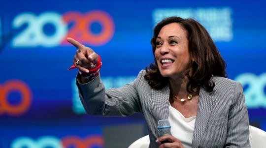 Democratic presidential candidate Sen. Kamala Harris, D-Calif., points to the crowd during the National Education Association Strong Public Schools Presidential Forum Friday, July 5, 2019, in Houston.