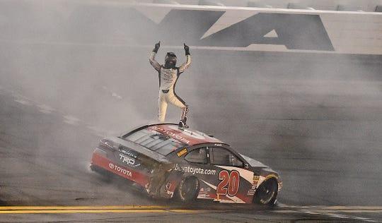Erik Jones (20) celebrates after winning the 2018 Coke Zero Sugar 400 at Daytona International Speedway.