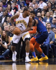 Kawhi Leonard and Paul George during a March game.