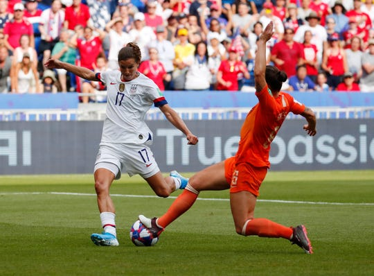 United States forward Tobin Heath (17) shoots against Netherlands midfielder Sherida Spitse (8) during the second half in the championship match of the FIFA Women's World Cup France 2019 at Stade de Lyon.
