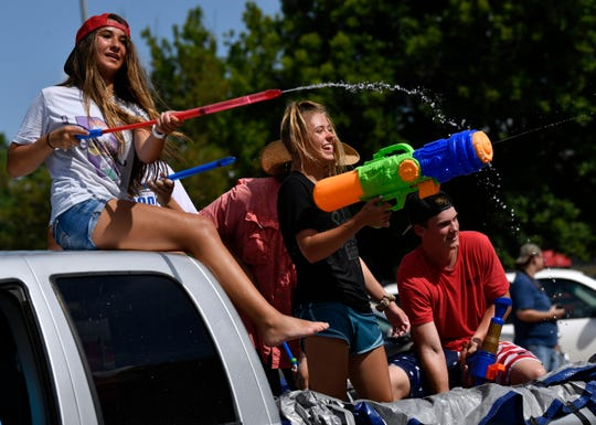 Teens squirt the crowd during Wednesday's Texas Cowboy Reunion parade in Stamford.