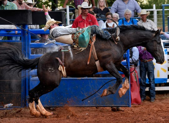 Kolt Dement holds on during bareback riding at the Texas Cowboy Reunion Wednesday. This is the 89th year for Stamford's rodeo.