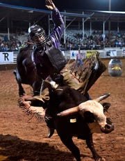 Austin Richardson tries to hold on for eight seconds during bull riding in Stamford at the Texas Cowboy Reunion Wednesday.