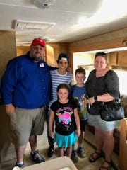 From left: Jeremy Latimer, Cameron Boyce, Annabelle Latimer, Abrahm Latimer and Sarah Latimer pose during a meet-and-greet at the 2018 Spiedie Fest.