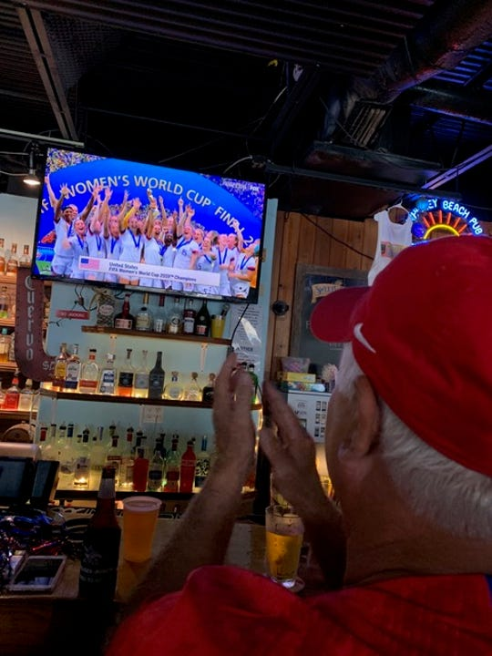 Satellite Beach's Mike Harris, father of Team USA goalkeeper Ashlyn Harris, applauds the team's celebration Sunday in Lyon, France, after beating the Netherlands 2-0 to win the World Cup.