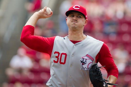 Cincinnati Reds starting pitcher Tyler Mahle (30) throws a pitch in the first inning of the MLB game between Cincinnati Reds and Cleveland Indians on Sunday, July 7, 2019, at Great American Ball Park in Cincinnati.