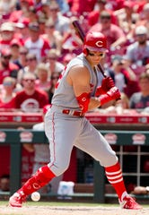 Cincinnati Reds left fielder Derek Dietrich (22) is hit by pitchin the fifth inning of the MLB game between Cincinnati Reds and Cleveland Indians on Sunday, July 7, 2019, at Great American Ball Park in Cincinnati.