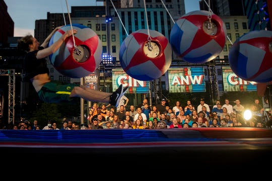 """Max Londberg, a reporter at The Enquirer, falls into a pool in the """"American Ninja Warrior"""" course Friday, May 24, 2019."""