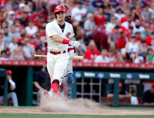 Jul 6, 2019; Cincinnati, OH, USA; Cincinnati Reds pinch hitter Scooter Gennett (3) reacts after striking out against the Cleveland Indians during the eighth inning at Great American Ball Park. Mandatory Credit: David Kohl-USA TODAY Sports