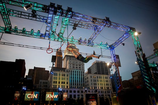 """Max Londberg, a reporter at The Enquirer, tests the """"American Ninja Warrior"""" course, before the show is filmed on Second Street in downtown Cincinnati Friday, May 24, 2019."""