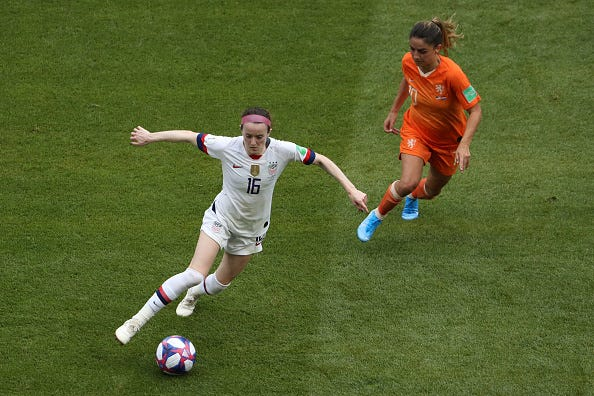 Rose Lavelle of the USA runs with the ball under pressure from Danielle Van De Donk of the Netherlands during the 2019 FIFA Women's World Cup France Final match between The United States of America and The Netherlands at Stade de Lyon on July 07, 2019 in Lyon, France.