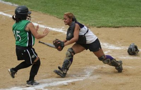 Old Bridge catcher Krystal Diaz tags a runner out at home plate in a Greater Middlesex Conference softball tournament semifinal game against South Plainfield on May 31, 2008 at Middlesex County College in Edison.