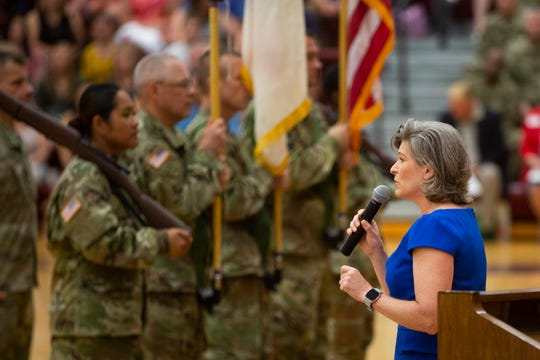 U.S. Sen. Joni Ernst (R-Iowa) speaks at the farewell ceremony for Army Reserve troops of the 103rd ESC on July 7, 2019, at Lincoln High School.