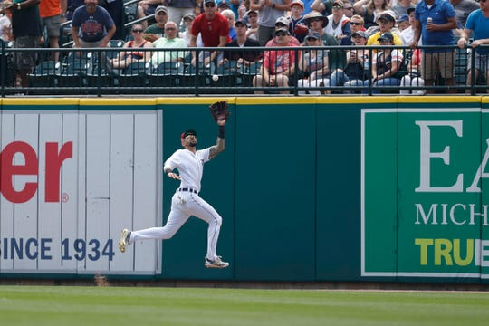 Tigers right fielder Nicholas Castellanos makes a jumping catch for an out during the first inning on Sunday, July 7, 2019, at Comerica Park.
