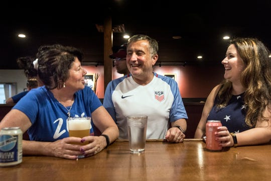 From left, Kim Pence, 58, Rick Pence, 61, and Jessica Pence, 33, of Livonia at the Team USA USWNT watch party at the Detroit City Clubhouse on Sunday.
