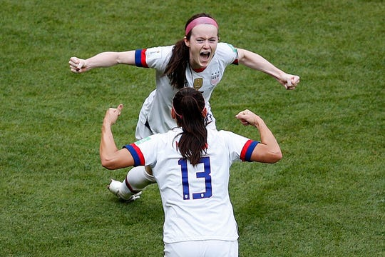 The United States' Rose Lavelle, rear, and teammate Alex Morgan celebrate after Lavelle scored the Americans' second goal.