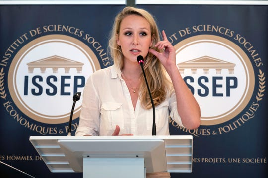 In this June 22, 2018 file photo, Marion Marechal delivers a speech as she inaugurates the Institute of Social Sciences, Economics and Politics (ISSEP) in Lyon, central France.