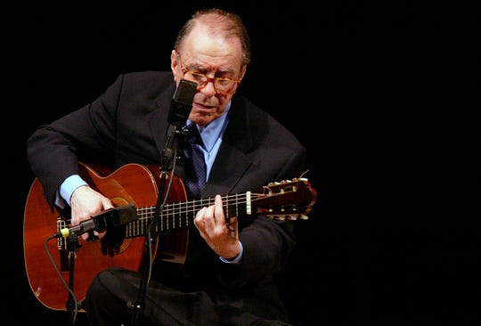 In this June 18, 2004 file photo, Brazilian composer Joao Gilberto performs at Carnegie Hall, in New York.