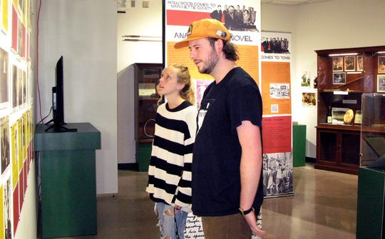 "Northern Michigan University student Cassidy Baarman and Hunter Laing, a gallery assistant at the Beaumier U.P. Heritage Center, look at the new exhibit ""Hollywood Comes to Marquette County: the making of Anatomy of a Murder"" June 21 in Marquette."