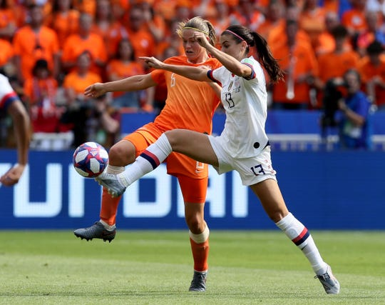Netherlands' Anouk Dekker, left, fights for the ball with United States' Alex Morgan.