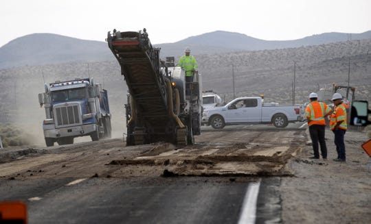Crews work on repairing a section of highway 178 in the aftermath of an earthquake Sunday, July 7, 2019, near Trona, Calif.