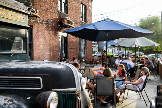 Dinners enjoy the patio at Walton's International Comfort Food on Parrett Street Friday evening, July 5, 2019.